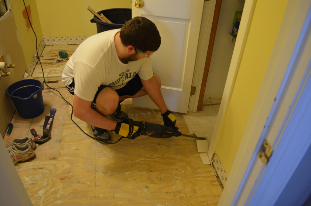 Scott removing floor tile.