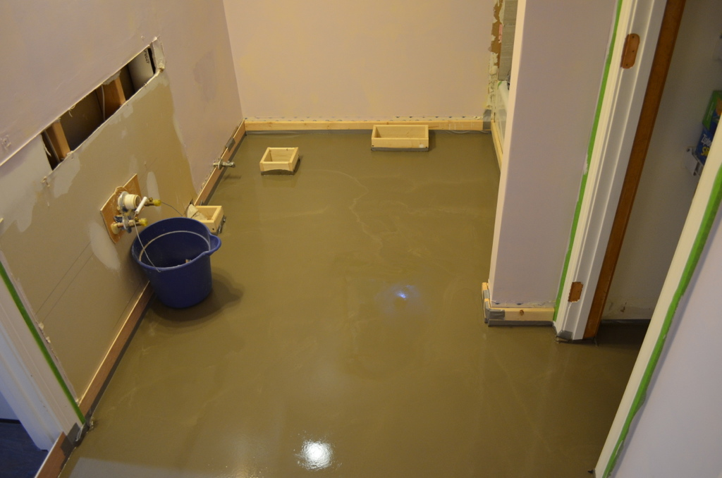 Self-leveling concrete before tiling the floor.