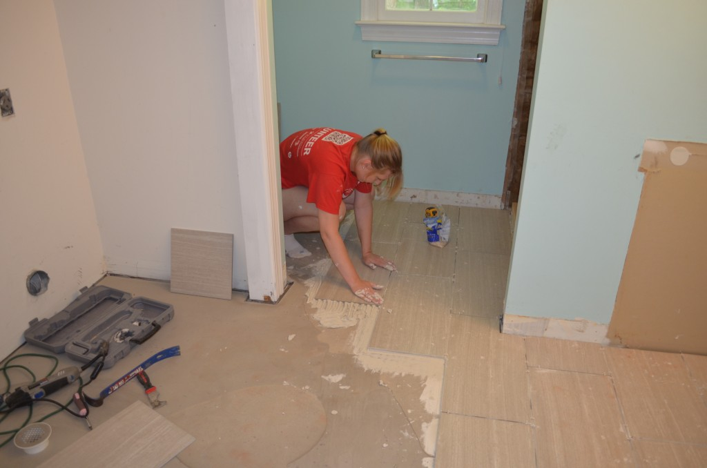 Laying tile.