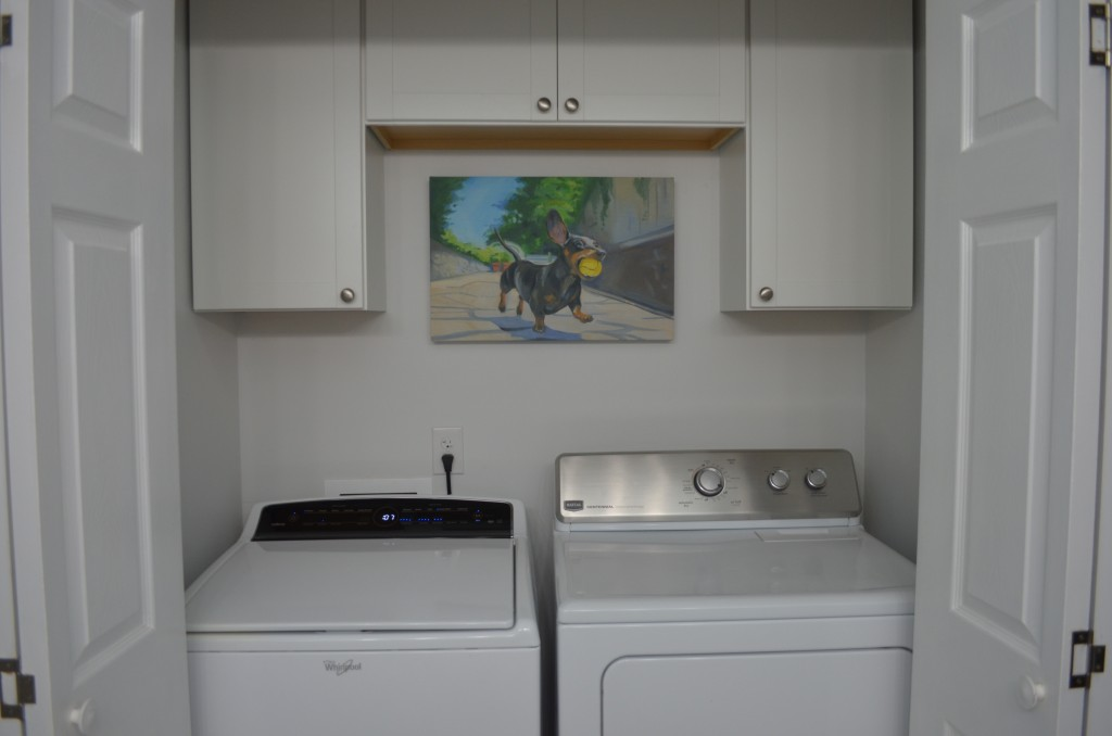 Finished laundry area. We added cabinets above the washer and dryer.